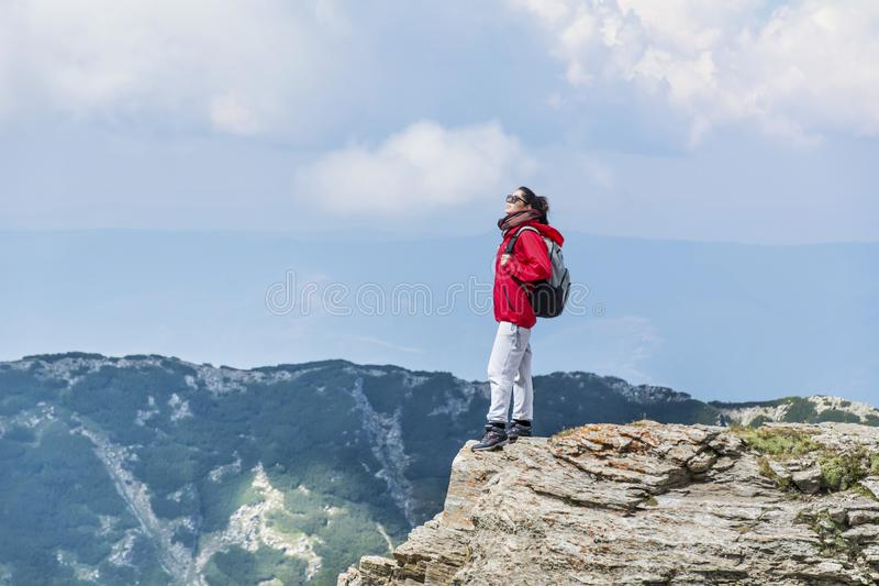 Mountaineer woman in Pirin mountain. Mountaineer woman on top of Pirin mountain ,Vihren peak,Bulgaria royalty free stock images