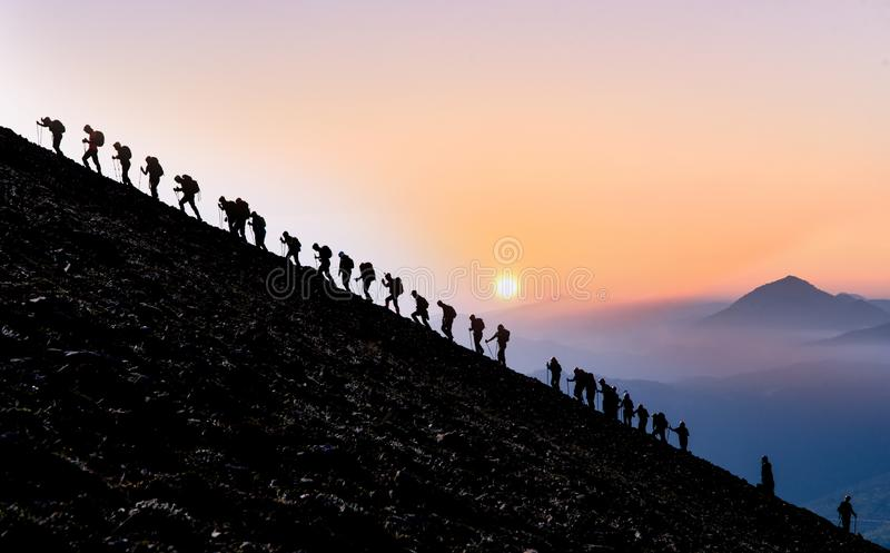 Mountaineering activity, different people of the same opinion, sporting together and spirit of togetherness stock photos