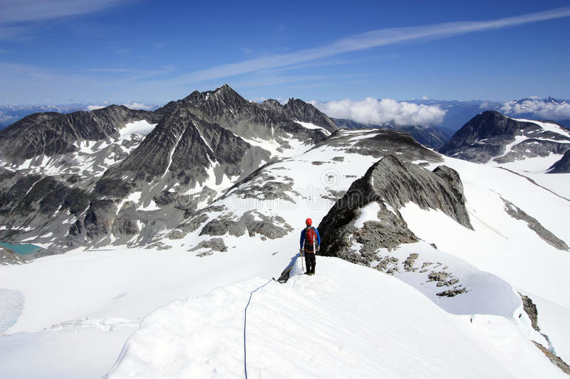 Mountaineering in Wedgemount Area of Garibaldi Park near Whistle. Unrecognizable person mountaineering in Wedgemount Area of Garibaldi Park near Whistler, BC royalty free stock image