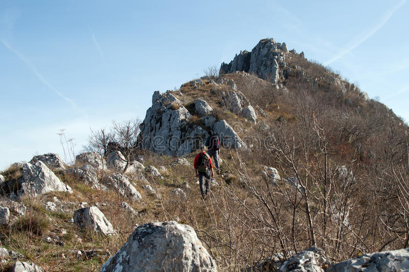 Mountaineers climbing. Landscape of the mountain peek with mountaineers royalty free stock photo
