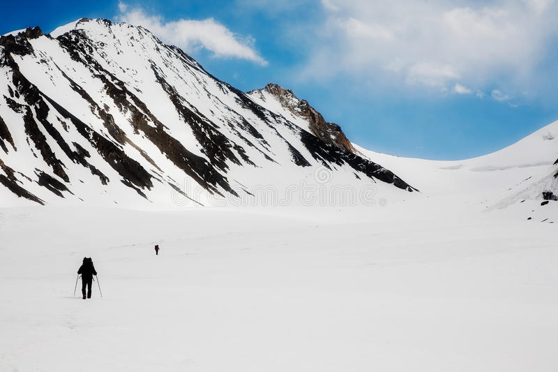 Mountaineers going to the pass stock photography