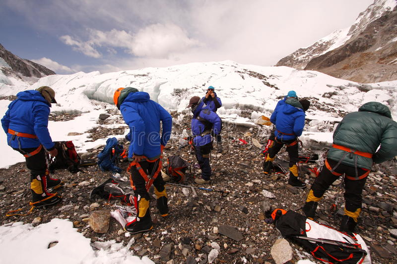 Mountaineers preparation. EVEREST BASE CAMP, NEPAL - APRIL 14, 2014: Unidentified mountaineers doing acclimatization in Khumbu glacier for summit push