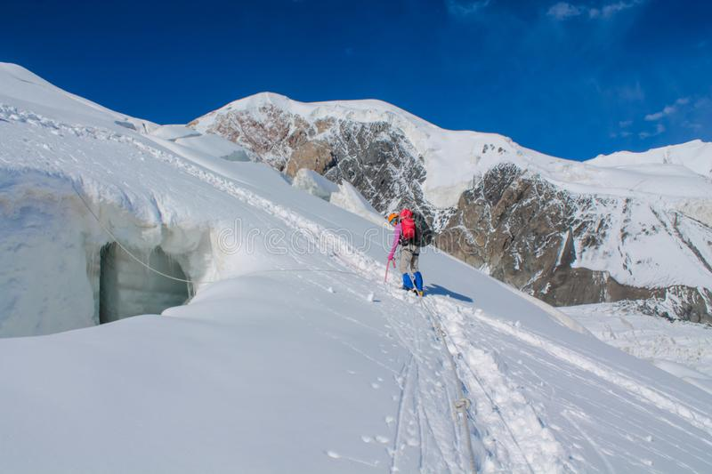 Mountaineers on the  snow of mountain glacier in Himalaya summit ascent. Mountaineers on snow of mountain glacier, climbing alpinist route. Alpinist with royalty free stock photo
