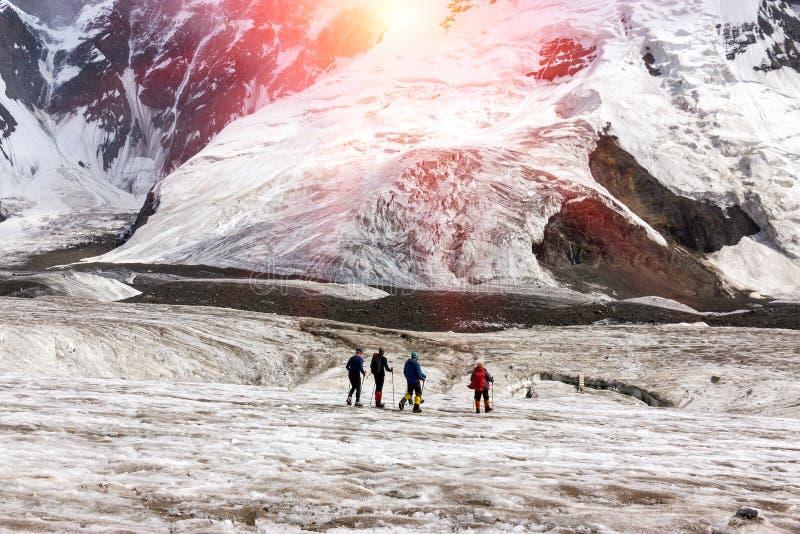 Mountaineers Walking Across Large Glacier stock image