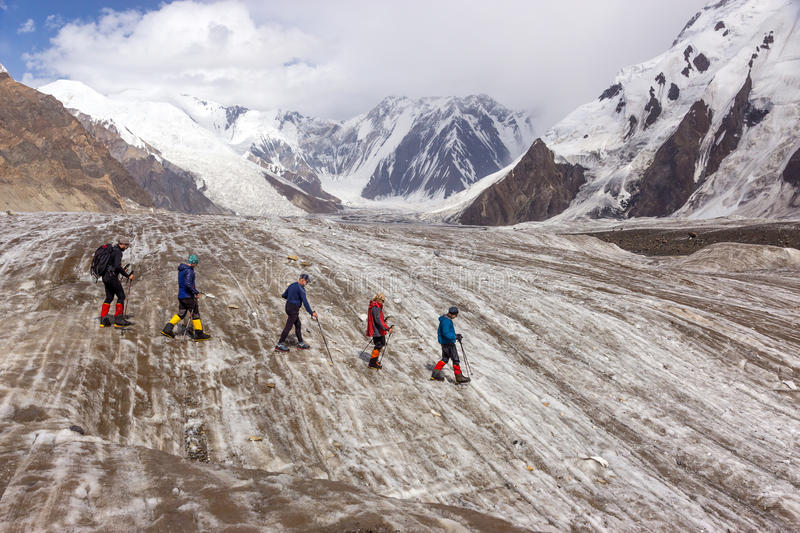 Mountaineers Walking Across Large Glacier royalty free stock photography