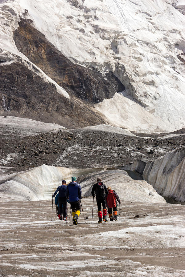 Mountaineers Walking Across Large Glacier royalty free stock photos
