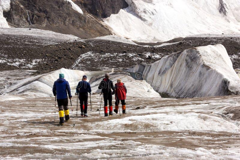Mountaineers Walking Across Large Glacier stock photos