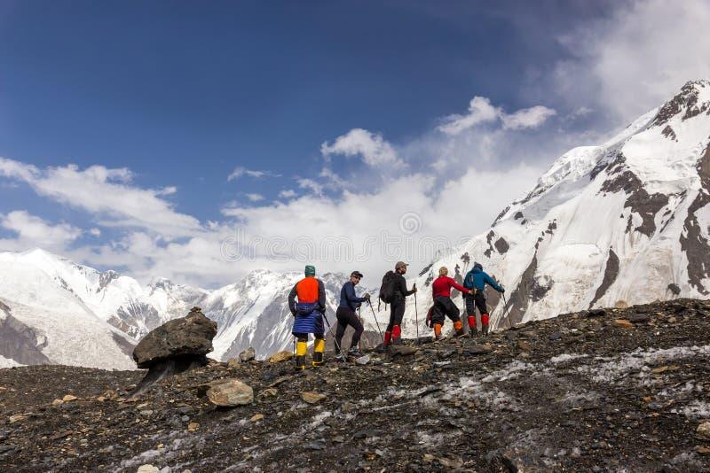 Mountaineers Walking Across Large Glacier stock images