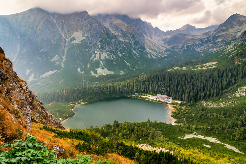 Mountainous landscape with lake in the valley stock image