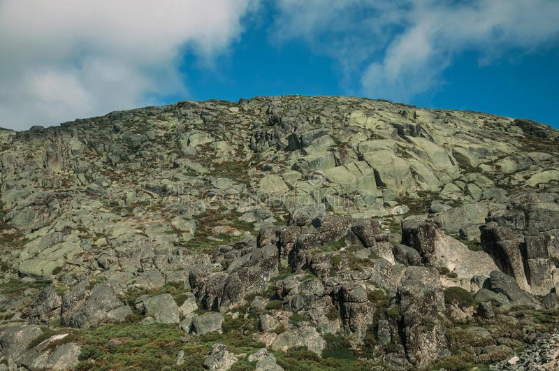 Mountainous landscape with rocky cliffs. Covered by green bushes in a sunny day, at the highlands of Serra da Estrela. The highest mountain range in continental stock photos