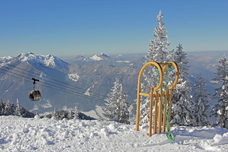 Mountainous landscape with ropeway and long horn sledge. Wallberg mountain bavaria royalty free stock photo