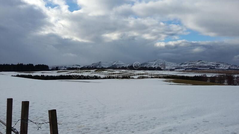 Mountainous landscape in Scotland during the snowy winter months stock photos