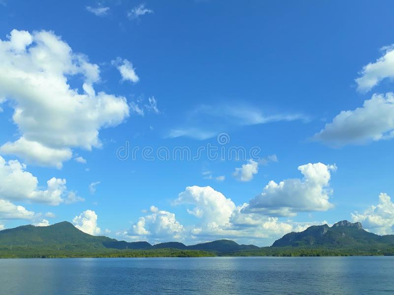 The mountainous reservoir is backdrop on a bright sky day. royalty free stock photos