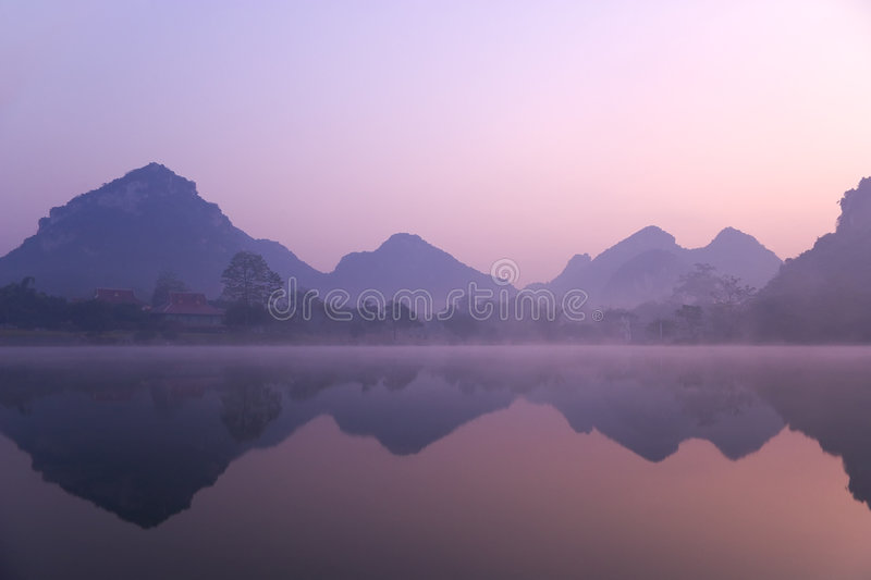 Mountains. Dawn, in the mountains shrouded in mist stock photography