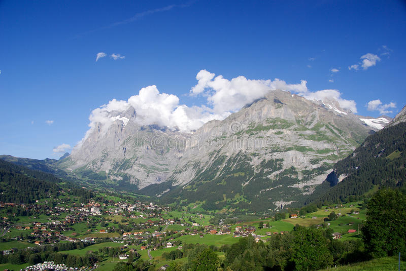 Mountains Above Grindelwald. The Swiss town of Grindelwald nestled at the foot of the Jungfrau mountain range, Switzerland stock image