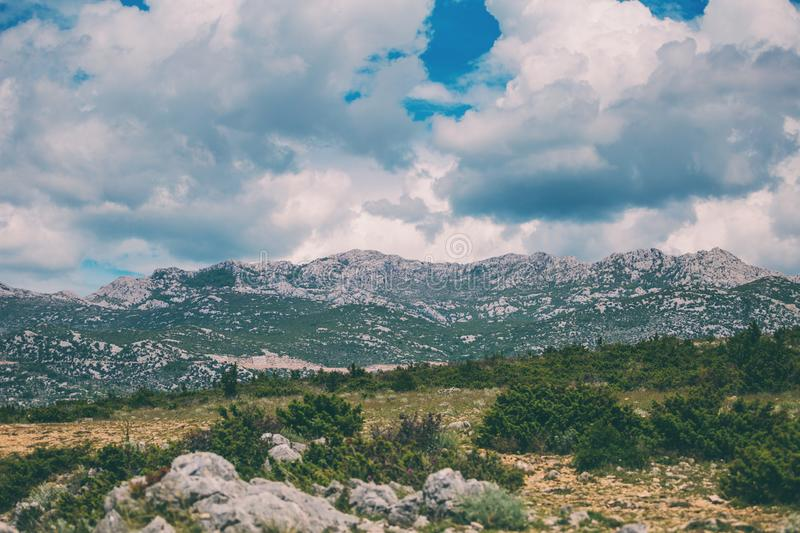 Mountains against a beautiful blue sky with fluffy clouds. Journey through Croatia. Krka National Park. Sights of the Balkan countries. Mountain range stock photo