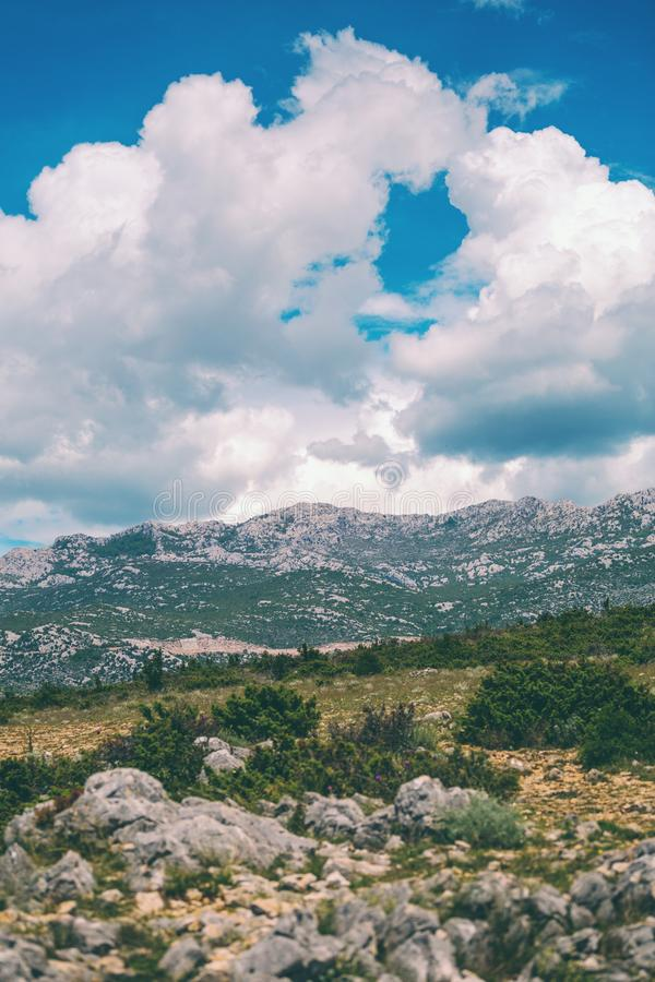 Mountains against a beautiful blue sky with fluffy clouds. Journey through Croatia. Krka National Park. Sights of the Balkan countries. Mountain range royalty free stock photo