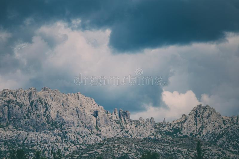 Mountains against a beautiful blue sky with fluffy clouds. Journey through Croatia. Krka National Park. Sights of the Balkan countries. Mountain range stock images
