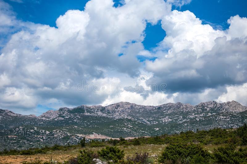 Mountains against a beautiful blue sky with fluffy clouds. Journey through Croatia. Krka National Park. Sights of the Balkan countries. Mountain range stock photography
