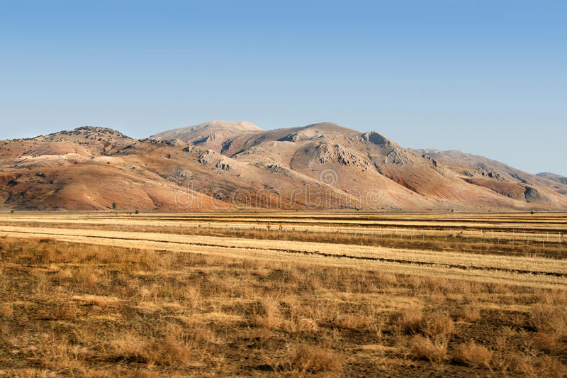 The mountains and agricultural fields in the autumn stock photo