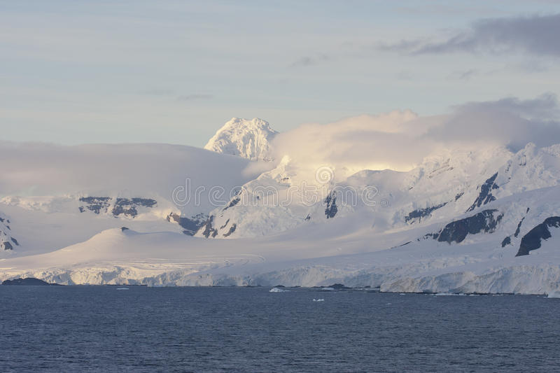 Mountains on the Antarctic Peninsula. In the first morning light royalty free stock image