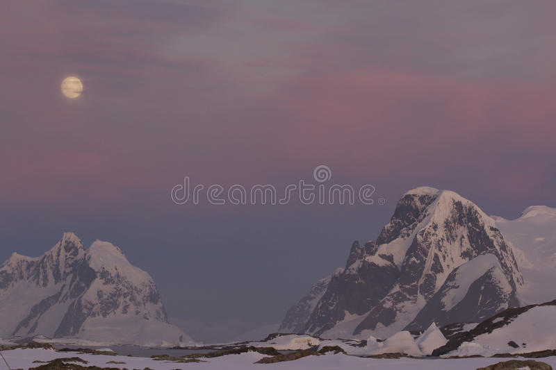 Mountains Of The Antarctic Peninsula In The Red Sunset In The Mo Stock Photo