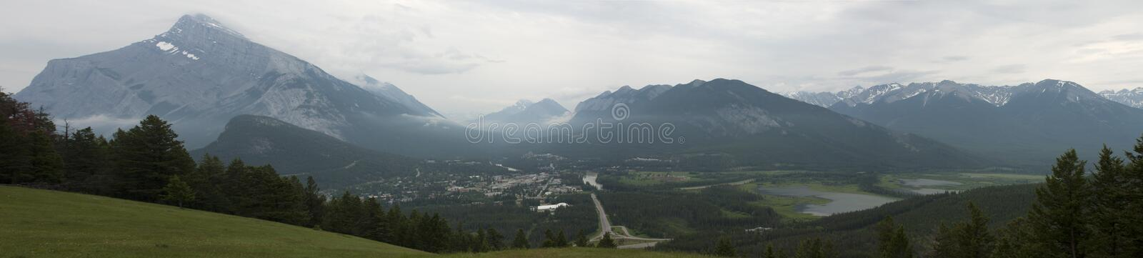 Mountains in the Background and Green Meadows during Daytime royalty free stock photography