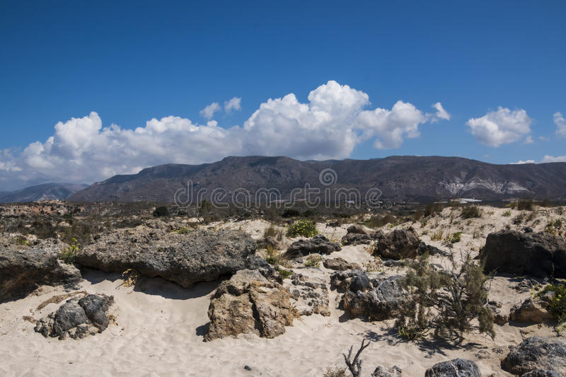 Mountains on a beach. Chania is the second largest city of Crete and the capital of the Chania regional unit. It lies along the north coast of the island, about royalty free stock photography