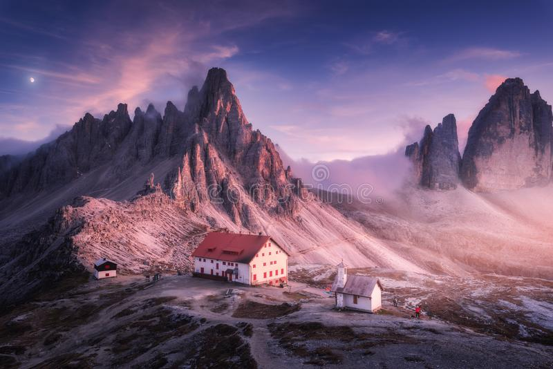 Mountains with beautiful house and church at sunset in autumn royalty free stock images