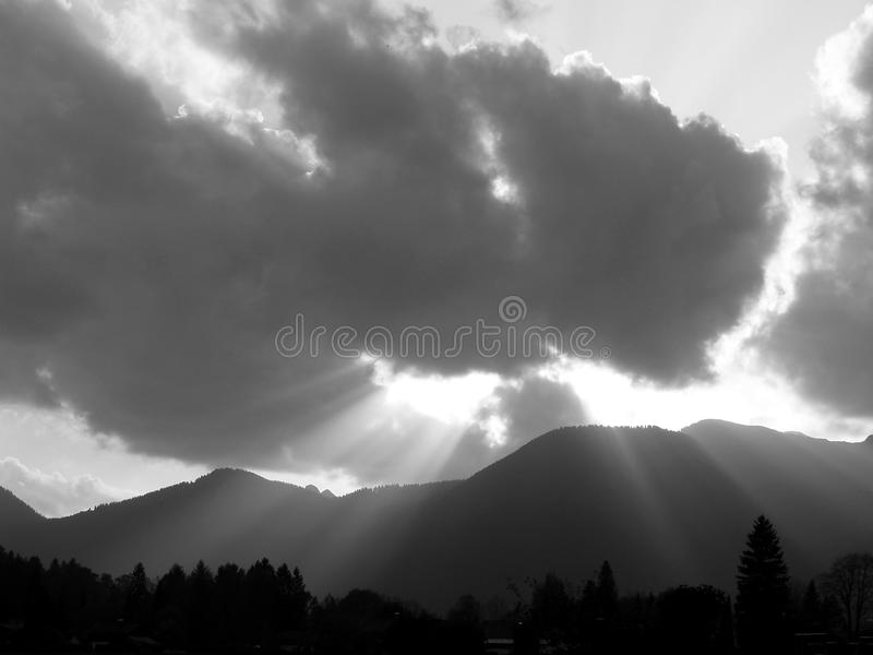 Eerie mood of light in the mountains in black and white stock photo
