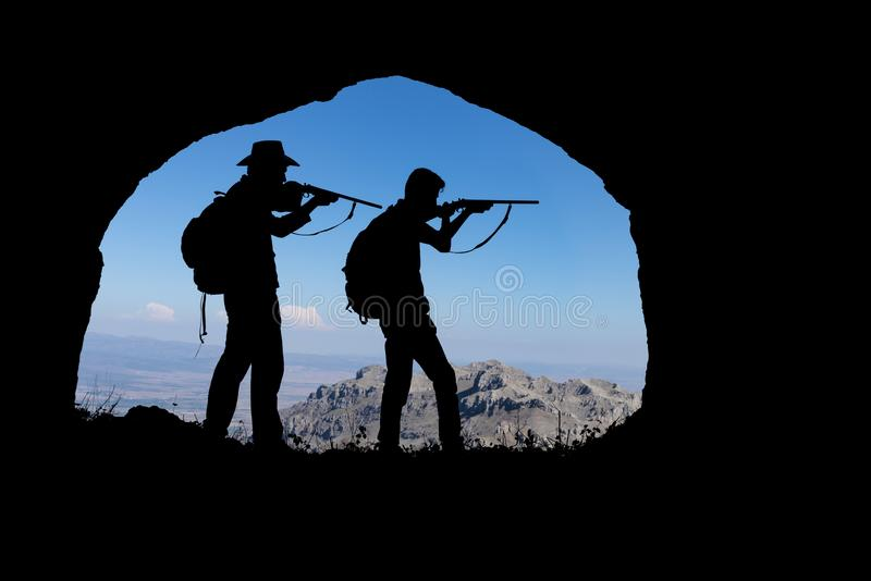 Mountains, caves and adventurous hunters royalty free stock image