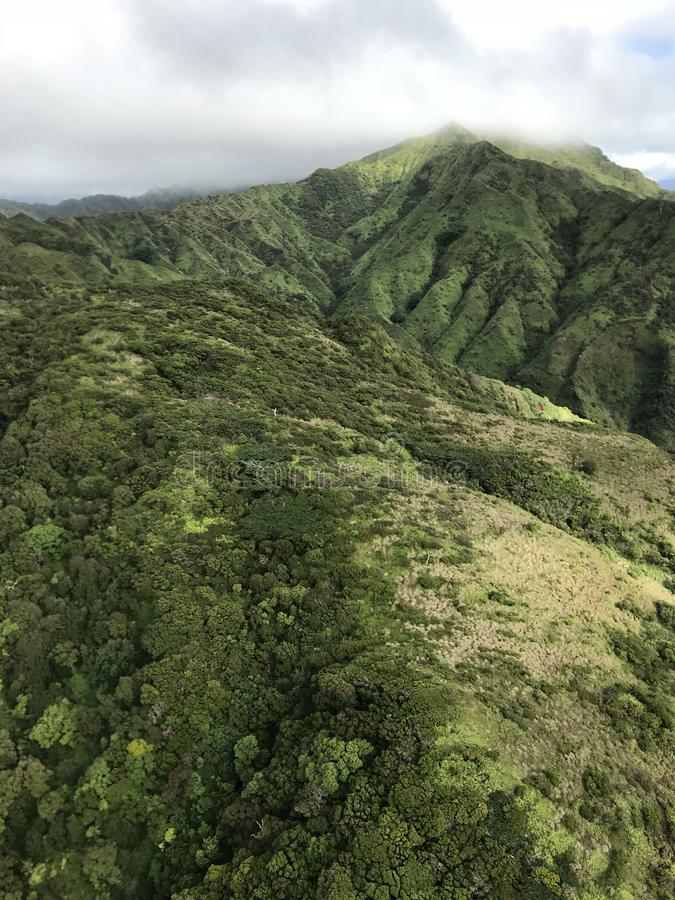 Mountains in central Kauai as seen from above. Kauai mountains from above with green landscape and foggy skies royalty free stock photography
