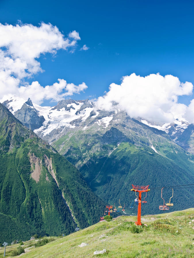 Mountains and chairlifts royalty free stock photo