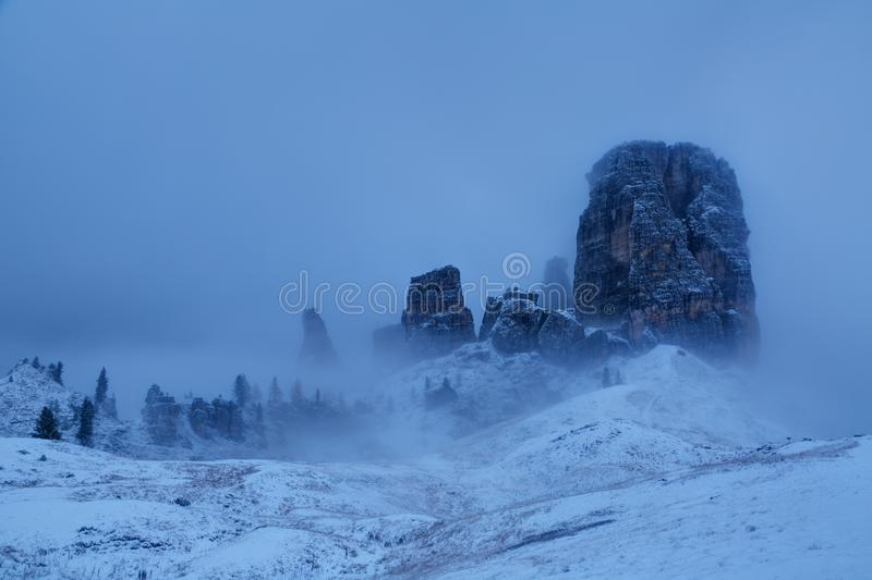 Mountains Cinque Torri The Five Pillars. Covered with snow, early autumn, Dolomites, Italy stock photo
