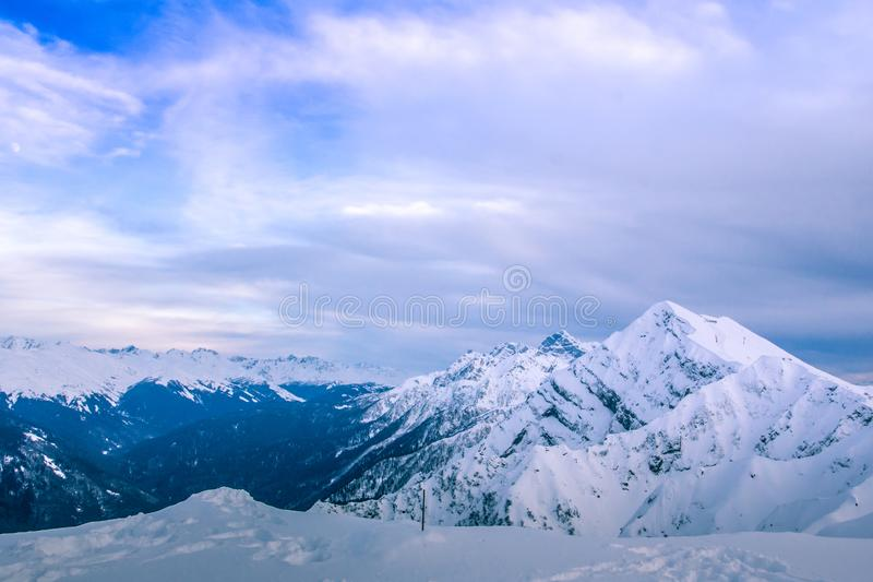 Great view from rose peak. Mountains and clouds hiding the sky. the fine given. Beautiful horizon. Infinity. Sochi, Russia. Rosa Khutor stock photography