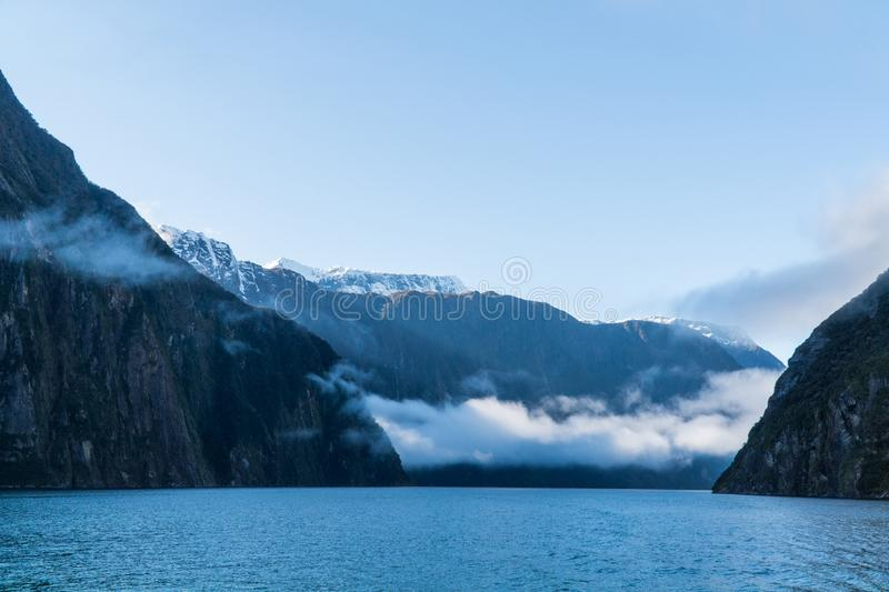 Mountains and clouds at Milford Sound, New Zealand royalty free stock photography