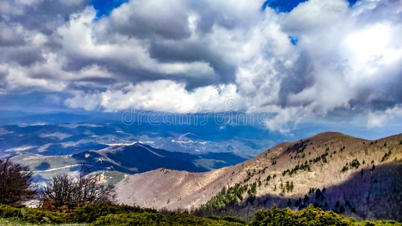 Mountains and clouds stock images