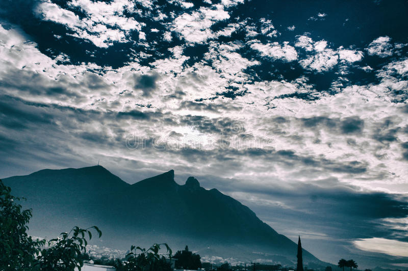 Mountains and cloudy sky royalty free stock photo