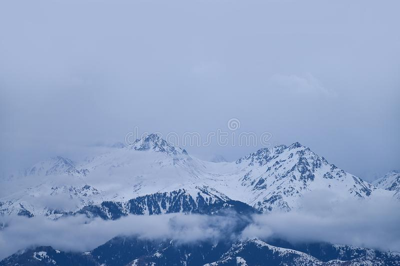 Mountains in cloudy weather, Kazakhstan, Qazaqstan, Almaty late autumn, winter, early spring. Panoramic view stock photography