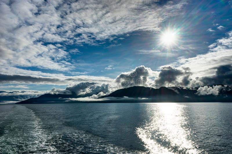 Mountains covered in clouds on a misty morning on the Ferry towa royalty free stock photo