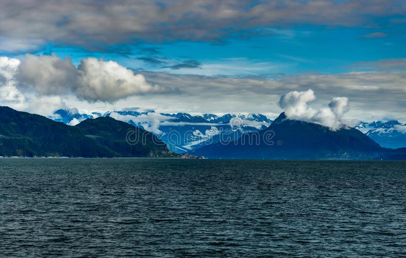 Mountains covered in clouds on a misty morning on the Ferry towa. Photo taken in Alaska, United States of America stock photos