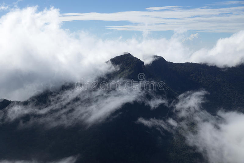 Mountains covered in mist, World`s End, Hortons Plain, Sri Lanka. World`s End, Hortons Plain, Sri Lanka stock photos