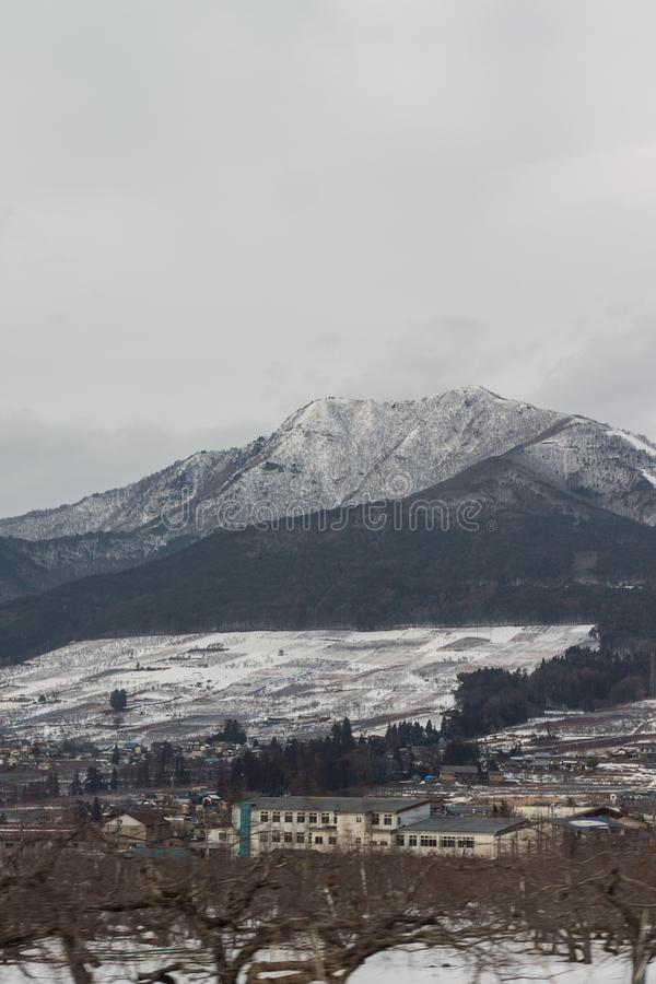 The Mountains covered in snow around Yudanaka, Japan.  stock photo