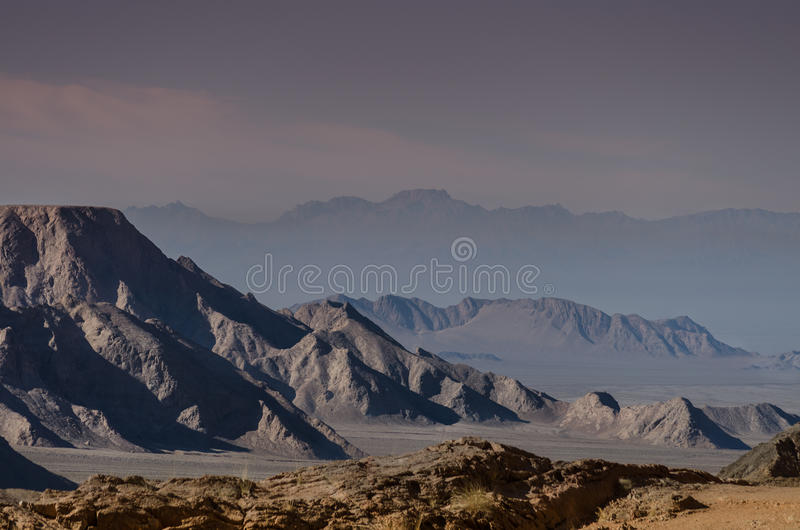 Mountains in Dasht-e Lut desert. Photography of mountains spreading across desert in central Iran royalty free stock photography