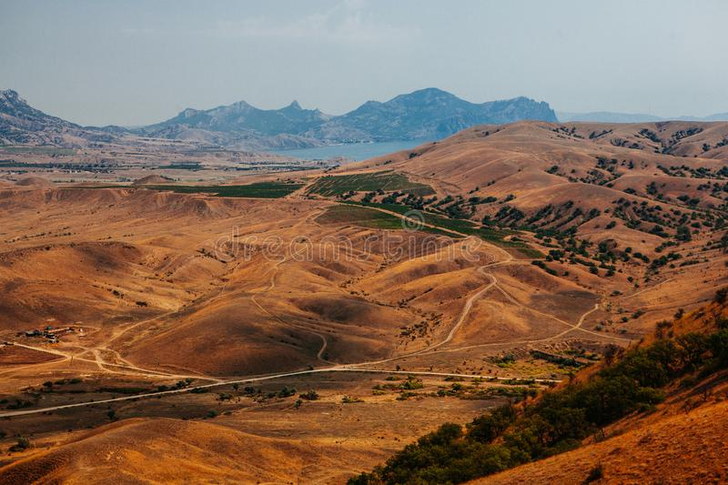 Mountains in the desert by day. The mountains in the big desert by beatiful a day royalty free stock photo