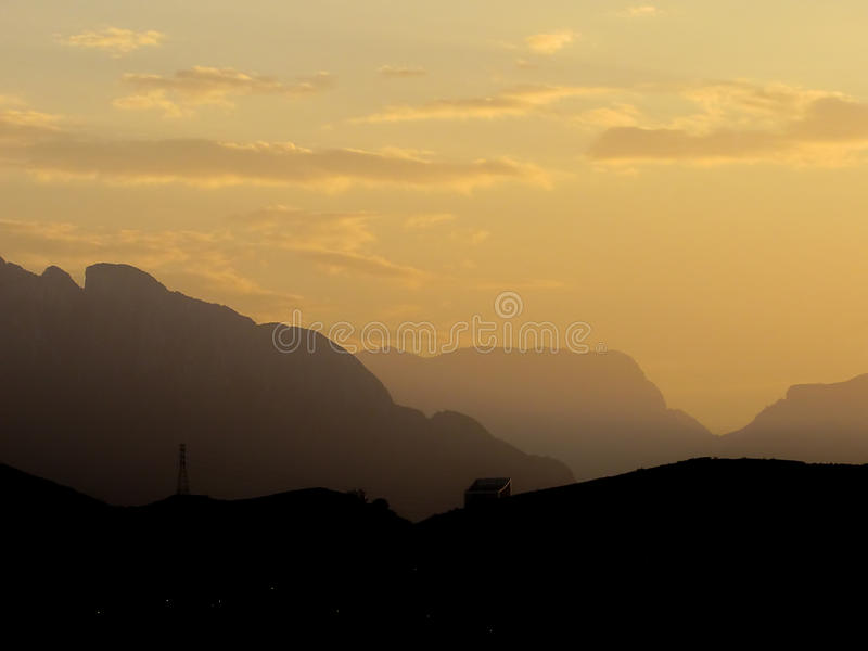 Mountains at Dusk. Cerro de la Silla and other mountains during dusk, at Monterrey, Mexico royalty free stock photos