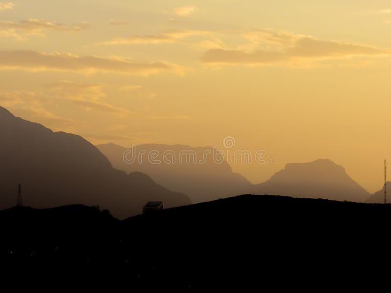 Mountains at Dusk. Cerro de la Silla and other mountains during dusk, at Monterrey, Mexico stock images