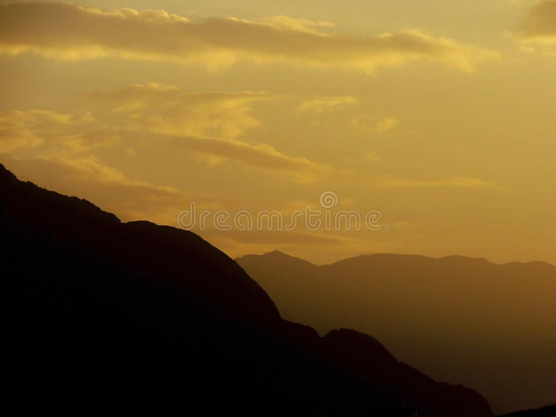 Mountains at Dusk. Cerro de la Silla and other mountains during dusk, at Monterrey, Mexico royalty free stock photo