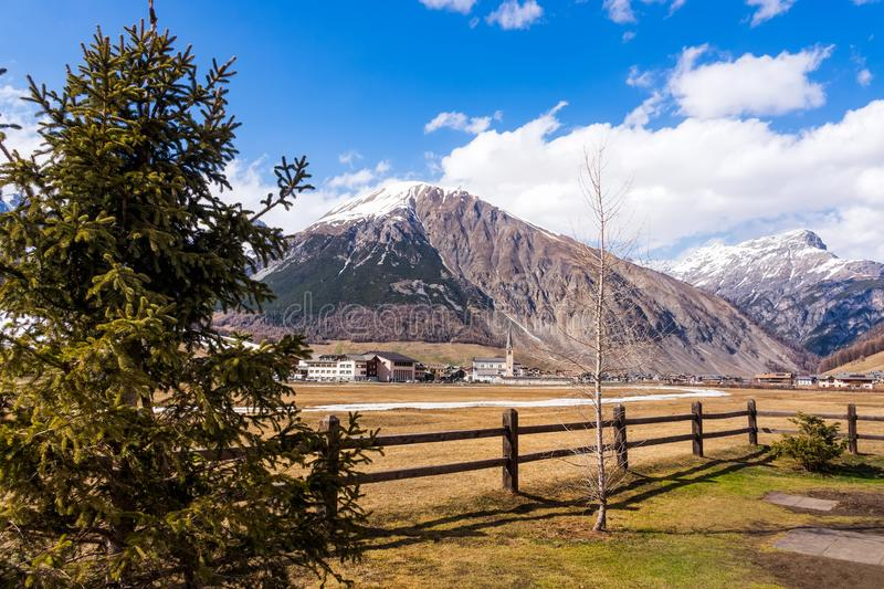 Mountains in early spring, Livigno village, Italy, Alps. Beautiful mountains in early spring, village at foot of a mountain, ski and snowboard holidays, Livigno royalty free stock photo