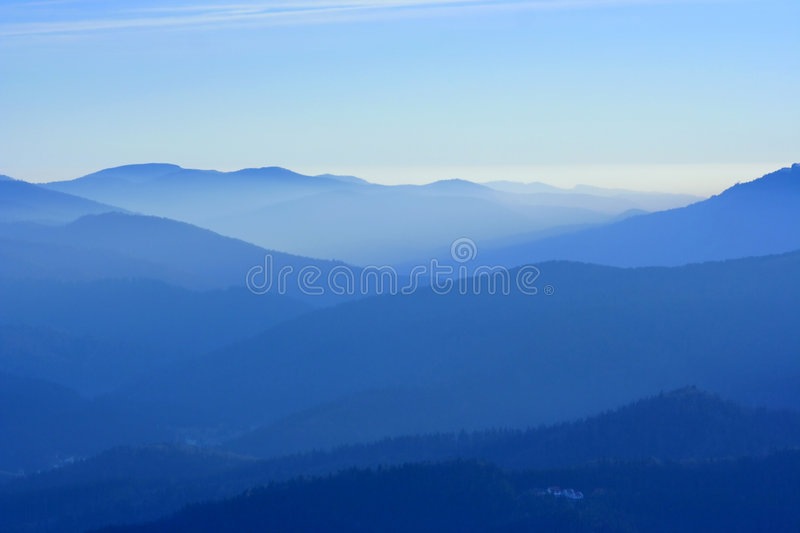 Mountains in the fog royalty free stock image